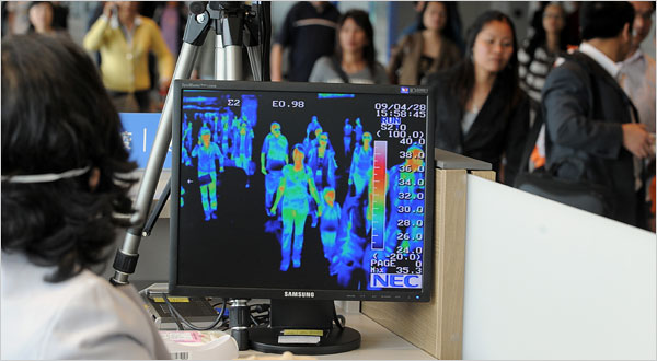 A quarantine officer monitored a thermal scanner Tuesday at Incheon International Airport in South Korea. Jung Yeon-Je/Agence France-Presse — Getty Images